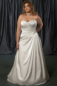 Plus size wedding dress, wedding gown for curvy woman. Flattering and slimming satin.