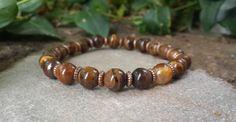 Hey, I found this really awesome Etsy listing at https://www.etsy.com/listing/211170836/mens-mala-bracelet-tiger-eye-bracelet