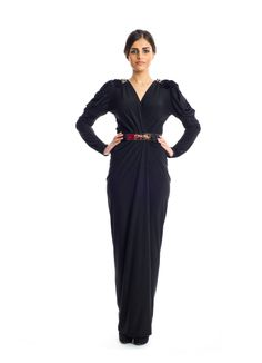 Step in style and feel like royalty in this new number by Xela! It features a silhouette designed in solid colors trimmed down to a V-neckline with puffy arms and studded details complimented by a metal waist belt to add sophistication to your wardrobe. This dress makes a perfect choice that special occasion.