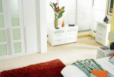 White panels, accompanied by glass makes for attractive white bedroom furniture http://www.sharps.co.uk/fitted-bedrooms/platinum/