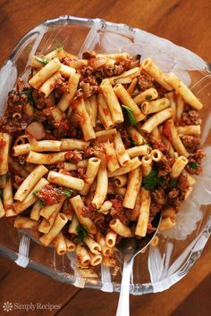 Penne pasta with a tomato meat sauce, with ground beef, onions, Italian seasoning, garlic, and basil. ~ SimplyRecipes.com