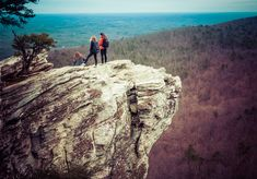 Many people head to Hanging Rock State Park to explore the famous Hanging Rock — and take photos. It can be an exhilarating experience — if you're not afraid of heights! Visit North Carolina, North Carolina Homes, State Parks, Visit Nc, Travel Usa, Adventure Travel, Travel Guide, Trip Advisor, Traveling By Yourself