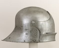 Visored sallet, ca. 1470–85 German/Swiss (Basel) Steel; Wt. 7 lb. 2 oz. (3232 g)  Generally shallow in form and covering only the upper half of the face, visored sallets were usually complemented by a separate bevor, a defence covering the chin and throat that was strapped around the back of the neck.   Posted from https://darksword-armory.com