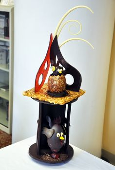 A chocolate showpiece with chicks and eggs for Easter.