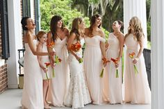 SAVANNAH WEDDINGS – Tori + David's Ford Plantation wedding planned by Anne Bone Events with an orange and yellow color palette, Anne Barge dress from Kleinfeld's, Amsale Bridesmaids Dresses, Flowers by Kiwi Fleur, Photographed by Donna Von Bruening
