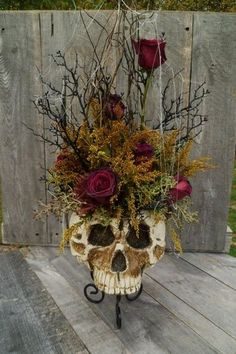 Two skull planter arrangements to be approx 4 feet high, bridal bouquet flowers add cempaxuchilt.