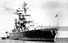 United States Navy Battleship USS West Virginia anchoring in an undisclosed naval port, date not given.