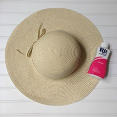 I have seen inexpensive straw hats in several craft stores this spring (this one is from AC Moore). They are SO easy to dye- it's a fun project and a great way to color coordinate with summer outfits.