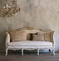 My Palette is very similar to this, but my Sofa is much more Contemporary...The idea of adding one Pillow in an Accent Color will awaken the entire wall.  Now to decide which shade of Purple...