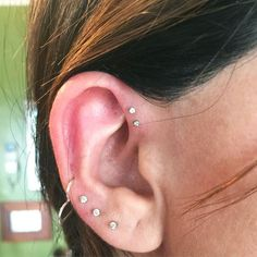 """L.A.'s 10 Coolest Ear-Piercing Combinations — & The Man Behind Them All #refinery29  http://www.refinery29.com/multiple-ear-piercing-ideas#slide-7  """"The forward helix again. This is a case of a girl wanting three holes in her forward helix, but I only did two. You have to have room for the piercings; If I'd crammed another one in, it would look too heavy. It looks perfect like this.""""..."""