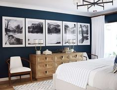 neutral bedroom design, modern bedroom design with large black and white artwork, white bedding and modern chandelier with navy wall in bedroom decor Bedroom Color Schemes, Bedroom Themes, Bedroom Colors, Home Decor Bedroom, Modern Bedroom, Bedroom Furniture, Bedroom Ideas, Bedroom Black, Pallet Furniture