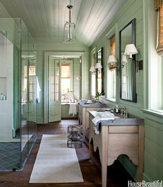 Soft green cottage bathroom with modern touches.