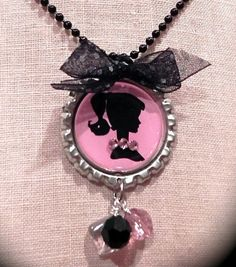 Can get a little metal punch to add danglies to bottle cap necklaces Bottle Cap Jewelry, Bottle Cap Necklace, Bottle Cap Art, Bottle Cap Images, Bottle Cap Projects, Bottle Cap Crafts, Diy Bottle, Beer Bottle, Diy Resin Crafts