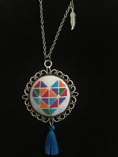 Handmade elegant cross stitch necklace with detailed heart pattern. I can adjust the length of the chain if you like. Let me know if you have any question
