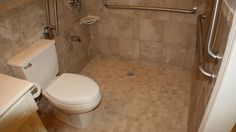 Handicap bathroom remodeling of a standard 5' x 9' bathroom with a Roll-in Shower (Barrier-Free). This bathroom was completely gutted-out and remodeled. Rein...