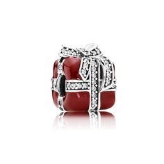 Make the excitement of Christmas and other festive occasions last all year with this fanciful gift charm. With its glossy red surface and sparkling bow, it's a true representation of the magic of the season. #PANDORA #PANDORAcharm