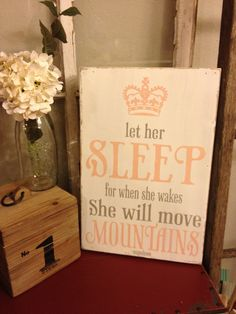 let her sleep, for when she wakes, she will move mountains - nursery sign with pink crown or for that busy mom. $34.00, via Etsy.
