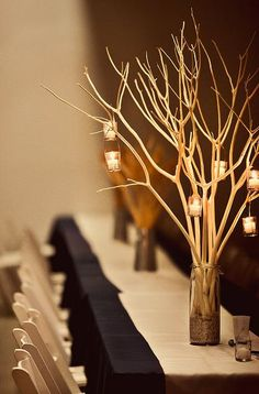 Spray Painted Gold Branch Centerpiece (Could use a bigger branch to hang family photos on.)