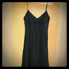 LBD you will want to have! Lined size 6 dress. Simple but really fun pleats. Wore twice to weddings; it is just dry cleaned and ready to go! I am 5.9 1/2 and it comes down mid-calf. LOFT Dresses