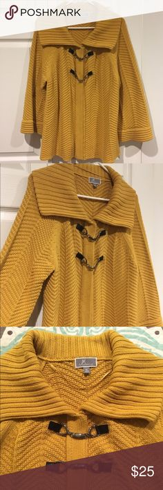 Comfy cable knit sweater cape Adorable mustard yellow long sleeve cable knit sweater. Has two buttons and metal clips in the front. Great condition. jm collection Sweaters Shrugs & Ponchos