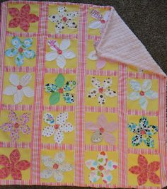 LOVE THIS QUILT!! Made out of baby clothes you can't bear to part with!