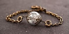 REAL DANDELION bracelet II - delicate blown glass orb with real dandelion seeds, little flowers and bronze chain. Adjustable.