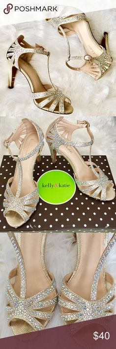 Glamorous Jeweled Heels by Kelly & Katie Sz 6 Absolutely gorgeous jeweled heels by Kelly & Katie. Worn once for a wedding; super comfortable & so beautiful; excellent condition! Comes w original box. Put a little glam in your look with the Catherine t-strap sandal from Kelly & Katie! With chic cutouts & reptile detail, this jeweled sandal is the perfect finishing touch for any evening outfit. Reptile embossed faux metallic suede upper T-strap with adjustable buckle Cutout details Rhinestone…