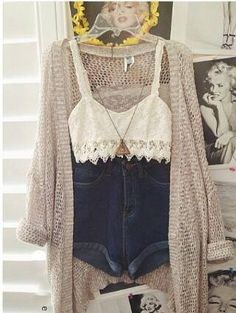Crop top. High waisted jean shorts. Over sized cardigan. Great, long, stylish necklace.