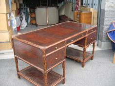 Maitland Smith Bamboo Leather Desk....ADD a fold down extension on the far side to pull up to the sofa/banquet with side chair to pull up to the drawer side. Instant dining room table/desk.