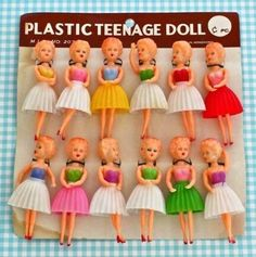 a card of plastic dolls, old stock from an Aussie corner shop