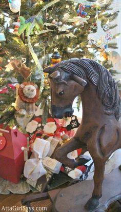 antique rocking horse under Christmas tree