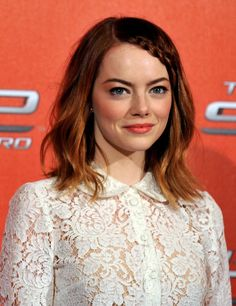 Emma Stone rocks a mini braid and tousled, medium-length locks