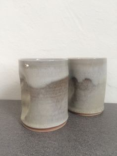 Our signature handprint tumblers are a dented porcelain design glazed in a rusted grey/light grey foodsafe glaze. The tumblers are microwave and dishwasher safe and make a great unique gift! Tumbler, Planter Pots, Unique Gifts, My Etsy Shop, Porcelain, Ceramics, Mugs, Design, Drinkware