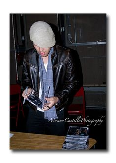 Prince Royce signs my CD at Sibley High School auditorium.