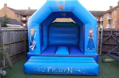 The Frozen Castle! Dimensions are 12ft long by 12ft high to hire this castle for your little princess' party email: info@bananabouncy...