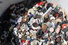 a barrel full of vintage buttons