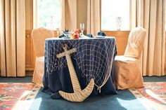 Our sweetheart table. Anchor. Fishing net. Nautical theme reception. Our harbor wedding. Nautical themed. Colors: navy, gray, and coral. Fells Point, Baltimore, Maryland.
