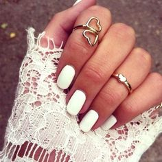 White nails, love the rings as well