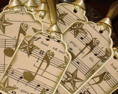 Gift tags made of vintage sheet music and embossed musical notes and stars. I envision something like this on your creatively wrapped gift!
