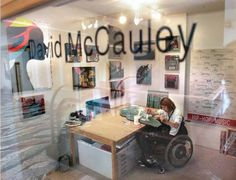 David McCauley, a mixed-media artist and the founder of Rise Up Gallery, works on a new piece at ArtCenter / South Florida in Miami Beach. Rise Up Gallery is a nonprofit organization that provides free art therapy workshops to the community and a venue in which emerging artists can exhibit their work. McCauley sustained a spinal cord injury in 2008. He has partnered with ArtLifting.com, an online marketplace for art created by disabled or homeless people.