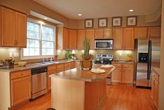 Open kitchen with wooden floors and large center island