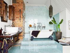 Bathroom: exposed brick and light blue tiles