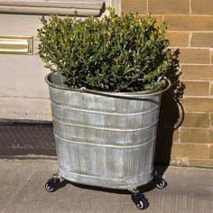 Plant your favorite flowers in our repurposed mop bucket planter. For more metal planters with wheels visit Antique Farmhouse. Metal Planters, Flower Planters, Garden Planters, Flower Pots, Fall Planters, Outdoor Planters, Garden Junk, Garden Art, Garden Ideas