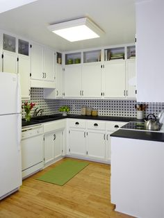 Look up. If you aren't comfortable with open shelving at eye level, try limiting it to the row of cabinets near the ceiling. In this kitchen, the homeowner removed the upper cabinet doors to enlarge the feel of the compact space and add decorative interest without putting her entire kitchenware collection out in the open.