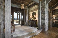 Rustic Entryway with Hardwood floors, Interior stacked stone wall, Glass pendant light, specialty door, slate floors, Columns