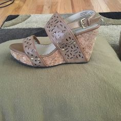 Adrienne vittadini wedge sandals Adrienne vittadini tan wedge sandals. Cork sole. Size 7. Adrienne Vittadini Shoes Sandals
