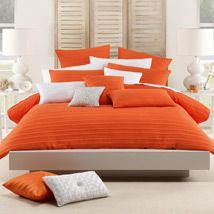 The elegant simplicity of Taya is given a burst of warmth with a rich shade of glowing orange that lifts and highlights the luxurious look of the beautifully ribbed and quilted fabric. A dramatic centrepiece for the bedroom, Taya Orange will command immediate attention with its striking presence.