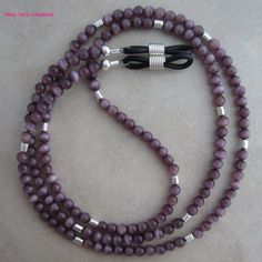 Purple cats eye and silver eyeglass chain for reading glasses.