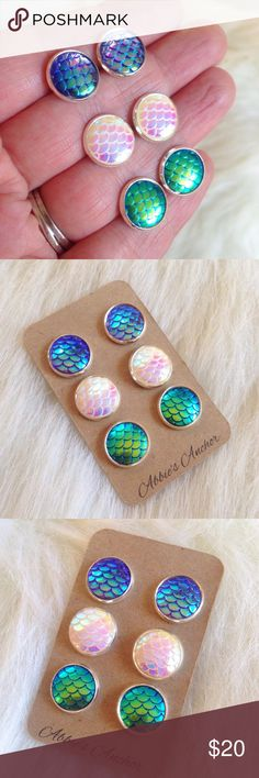 """3 pairs of mermaid scale stud earrings This listing is for all 3 pairs of mermaid scale stud earrings! Colors include: Purple/lavender, opal color and green/blue. Each pair is iridescent and flashes between colors in different movements and lighting. Very stunning and eye catching✨Checkout my closet for other colors! Earrings measure 1/2"""" around and are nickel & lead free. Handmade by me & brand new! Bundle & save 15% on 3+ itemsTags: Mermaid, gift, siren, nautical, dragon, festival, ocean…"""