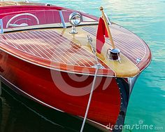 Classic wooden boat moored at dock